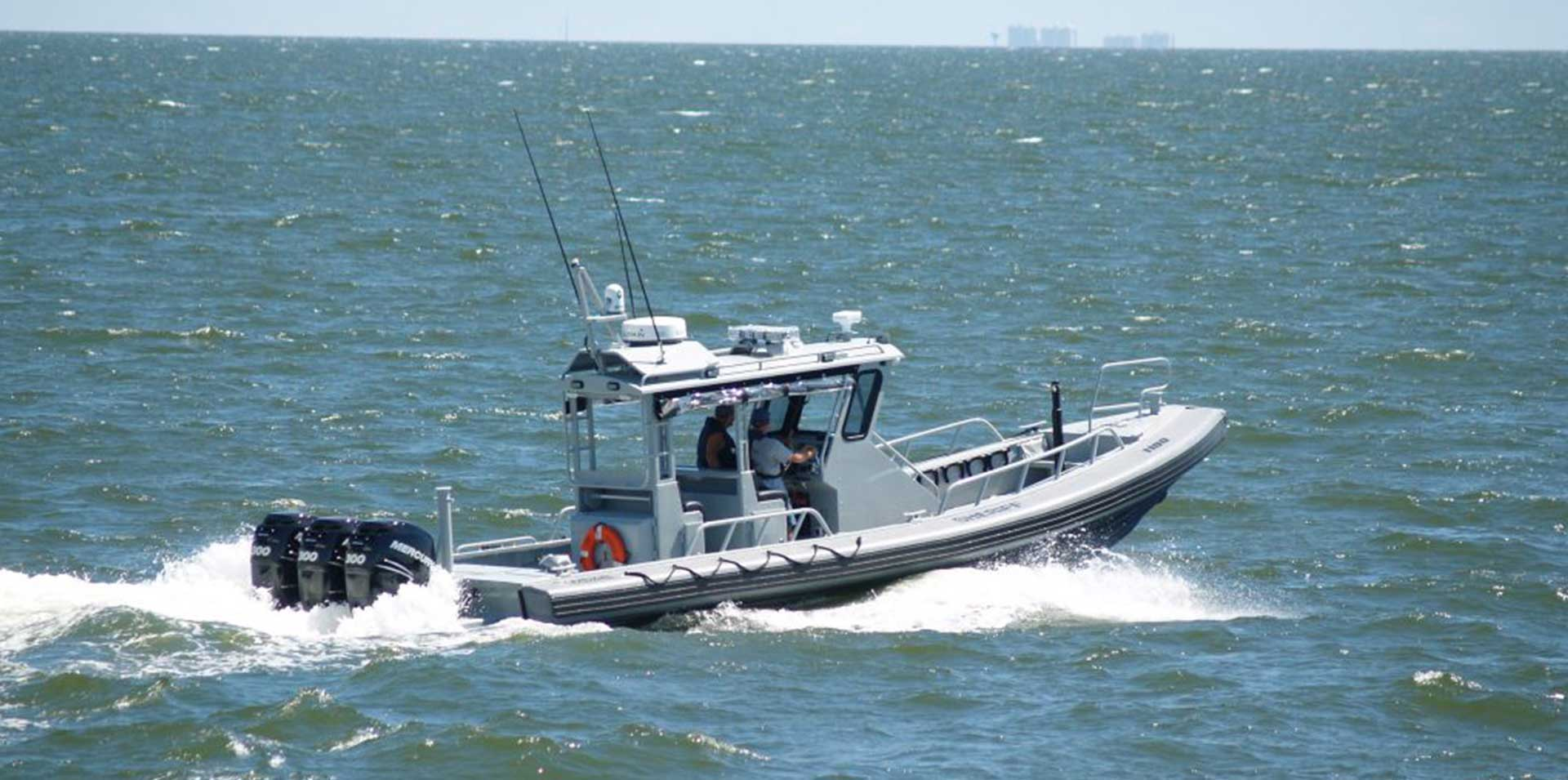 Silver Ships Ambar Series AM 1100 patrol boat with pilothouse and outboards