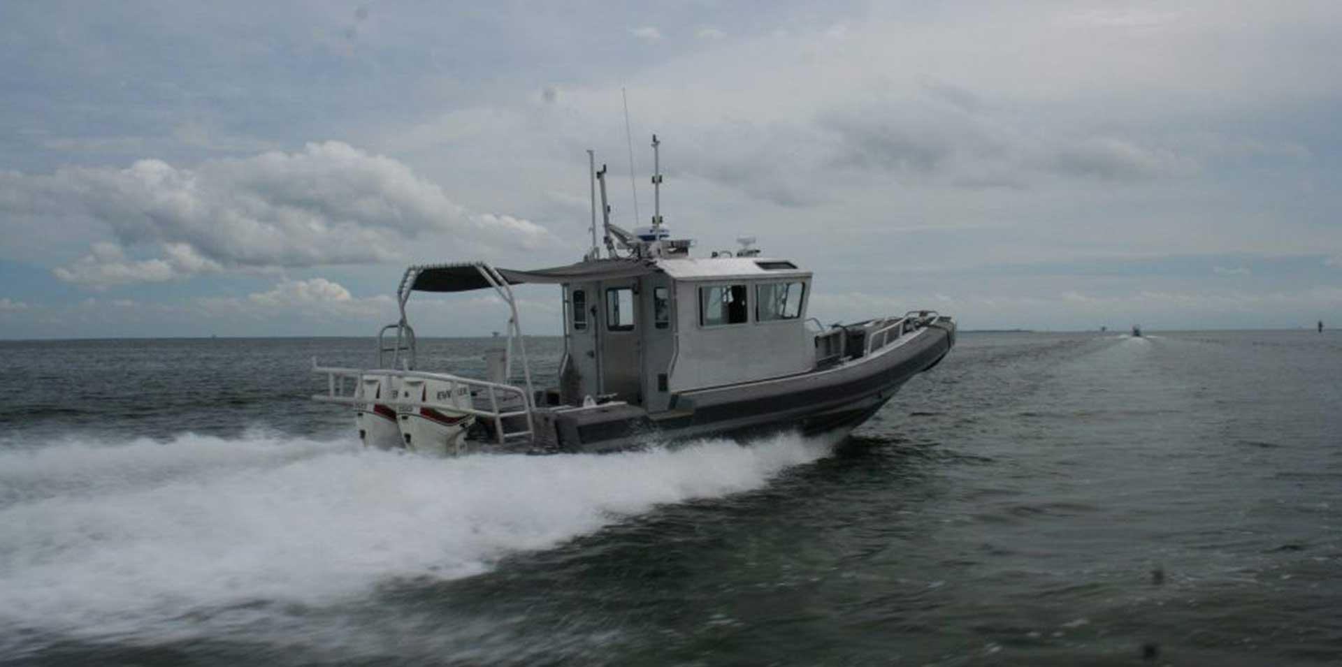 Silver Ships Ambar Series AM 1100 patrol boat with full pilothouse and awning back view