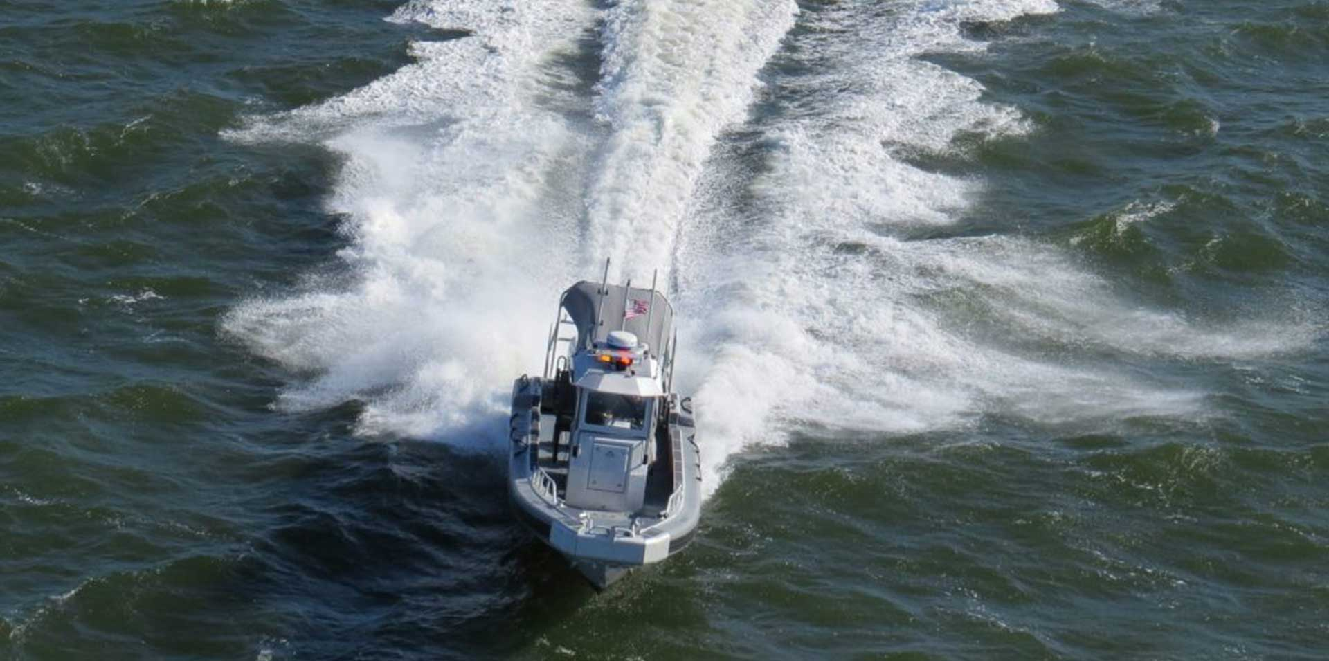 Silve Ships Ambar Series AM 1100 police boat hitting ocean waves