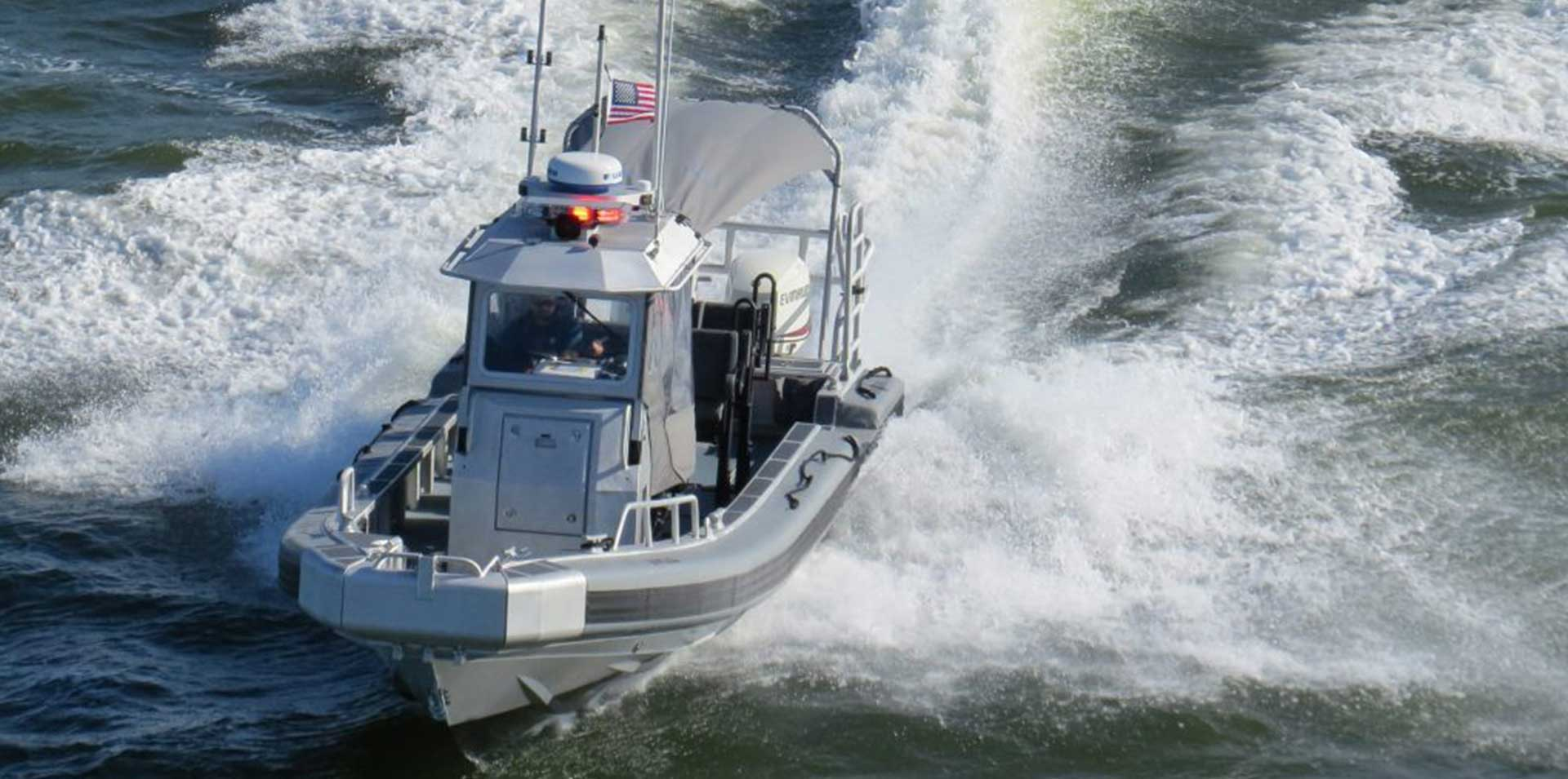 Silver Ships Ambar Series AM 1100 police boat on the ocean