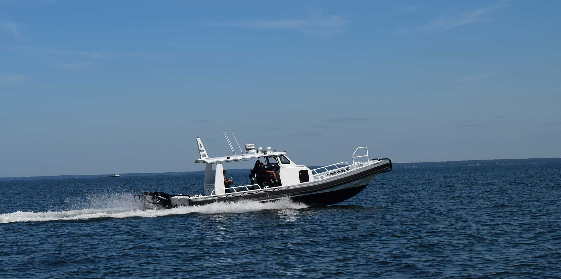 Silver Ships Ambar Series AM 1200 patrol boat on the ocean with open pilothouse