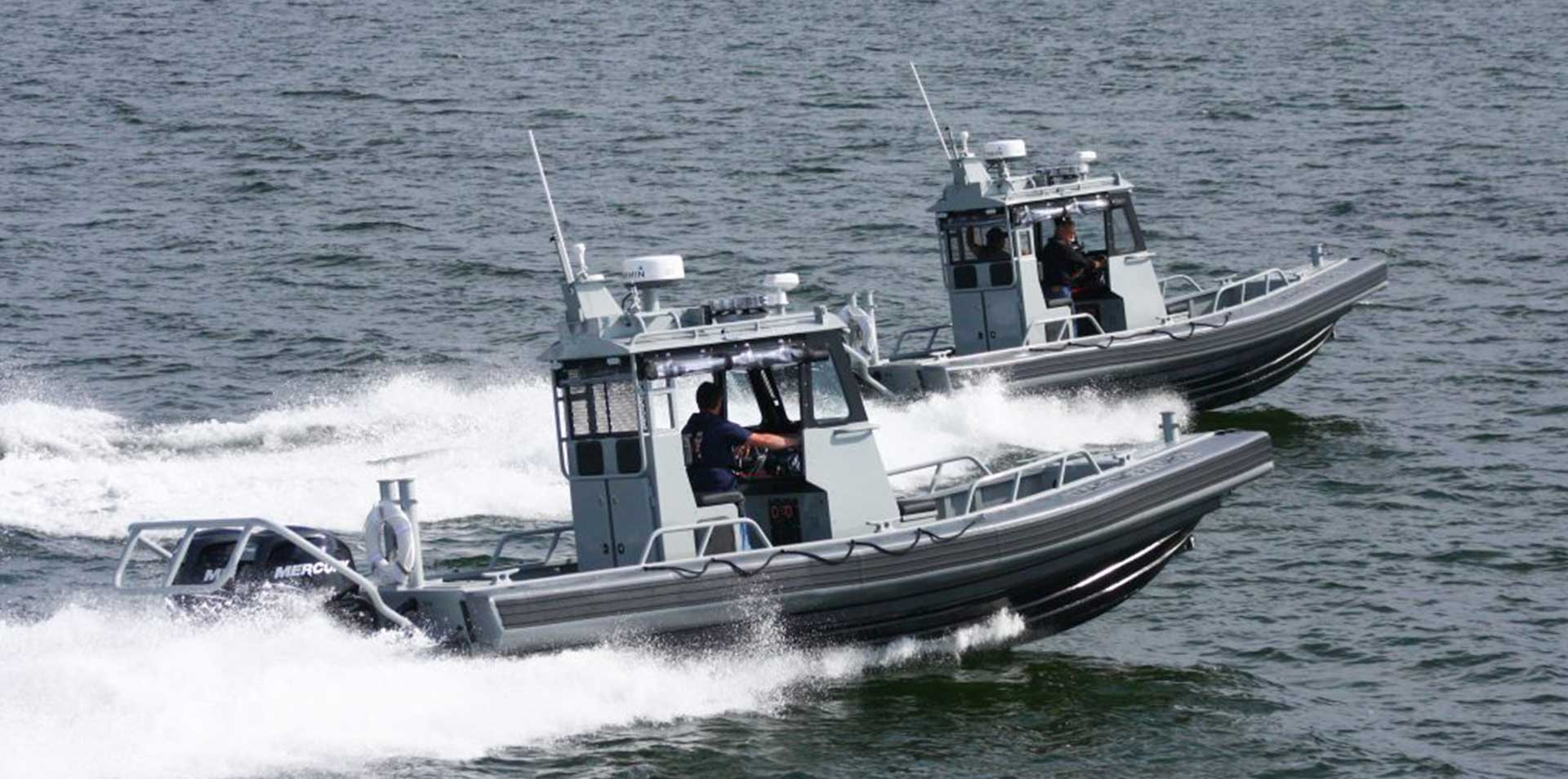 Silver Ships Ambar Series AM 800 military boats on ocean