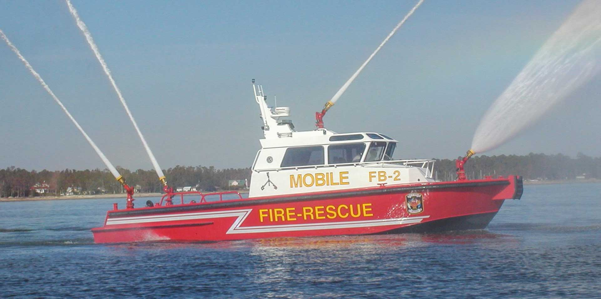 Silver Ships Mobile fire and rescue boat spraying all four hoses