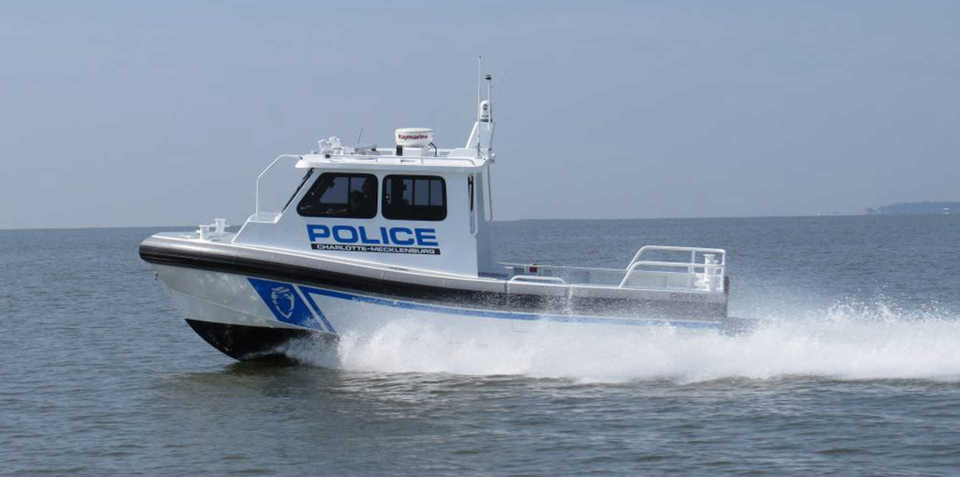 Small police boat with full pilothouse