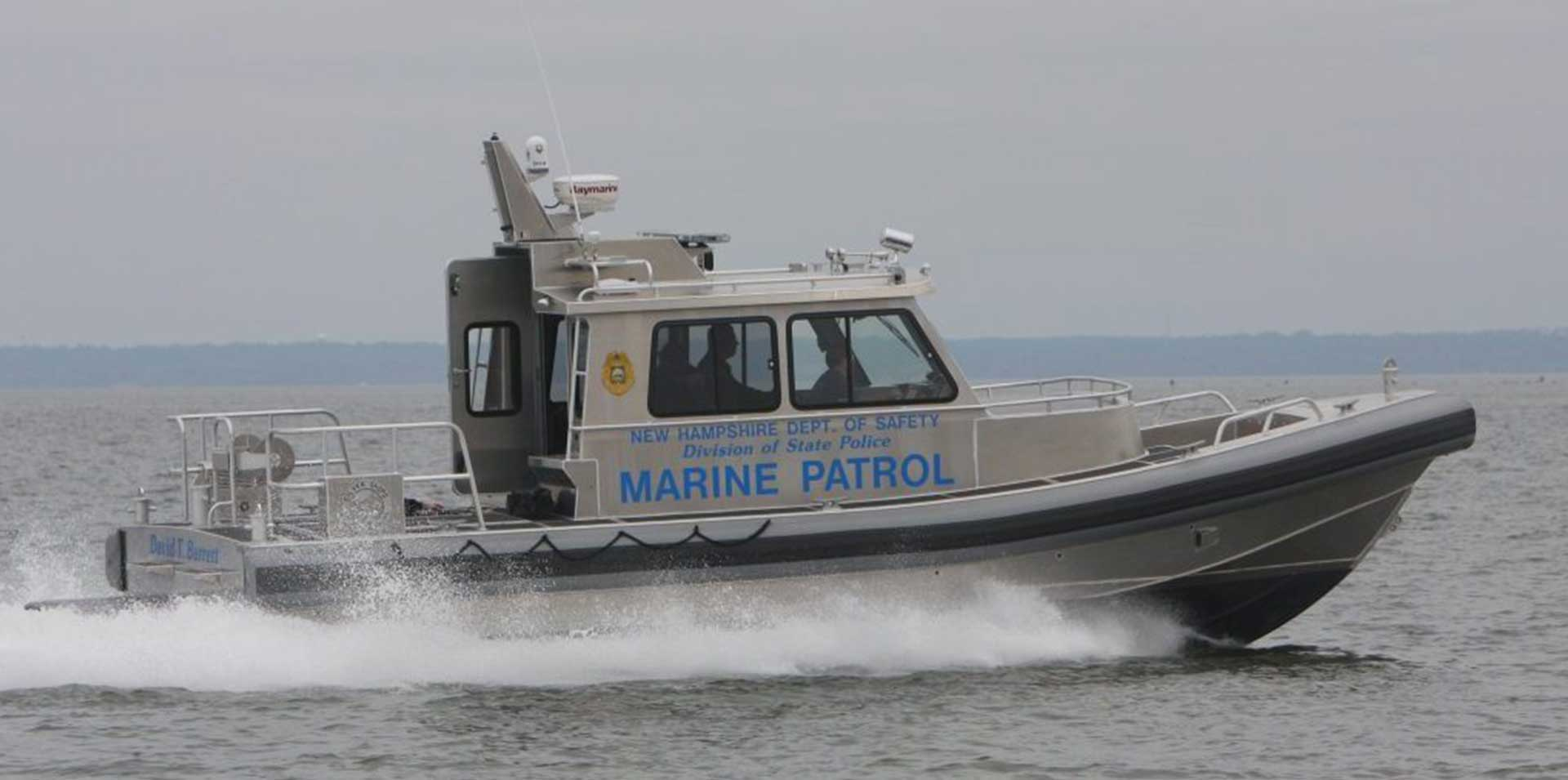 Silver Ships law enforcement marine patrol boat on ocean