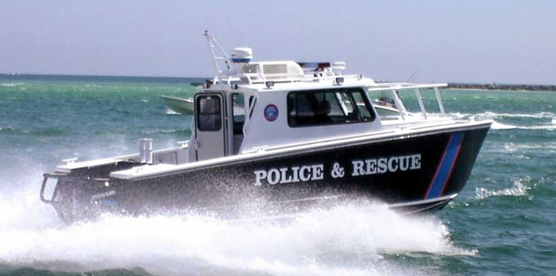 Silver Ships law enforcement police and rescue boat on ocean