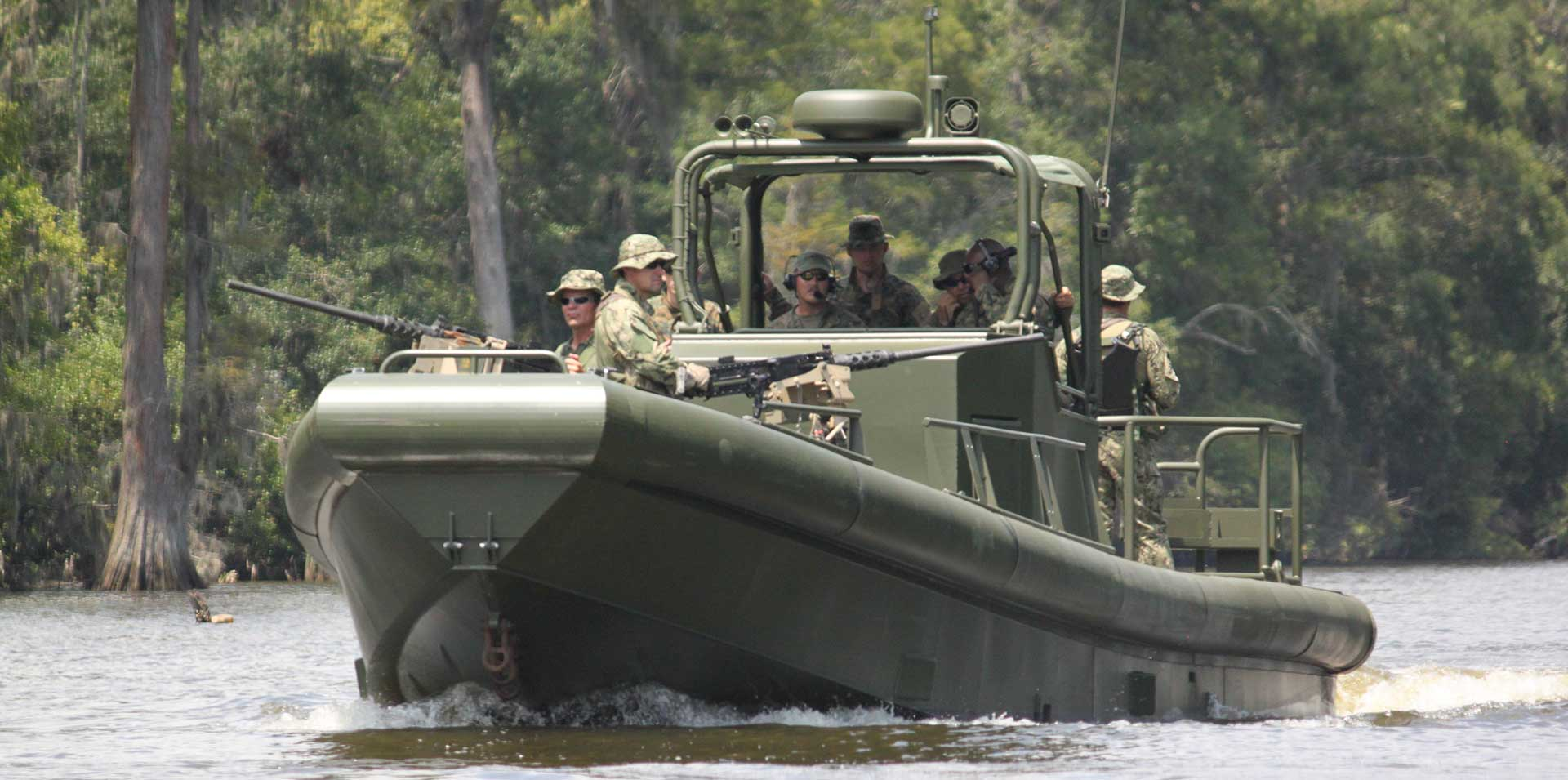 Silver Ships riverine patrol boat with soldiers and weapon mounts