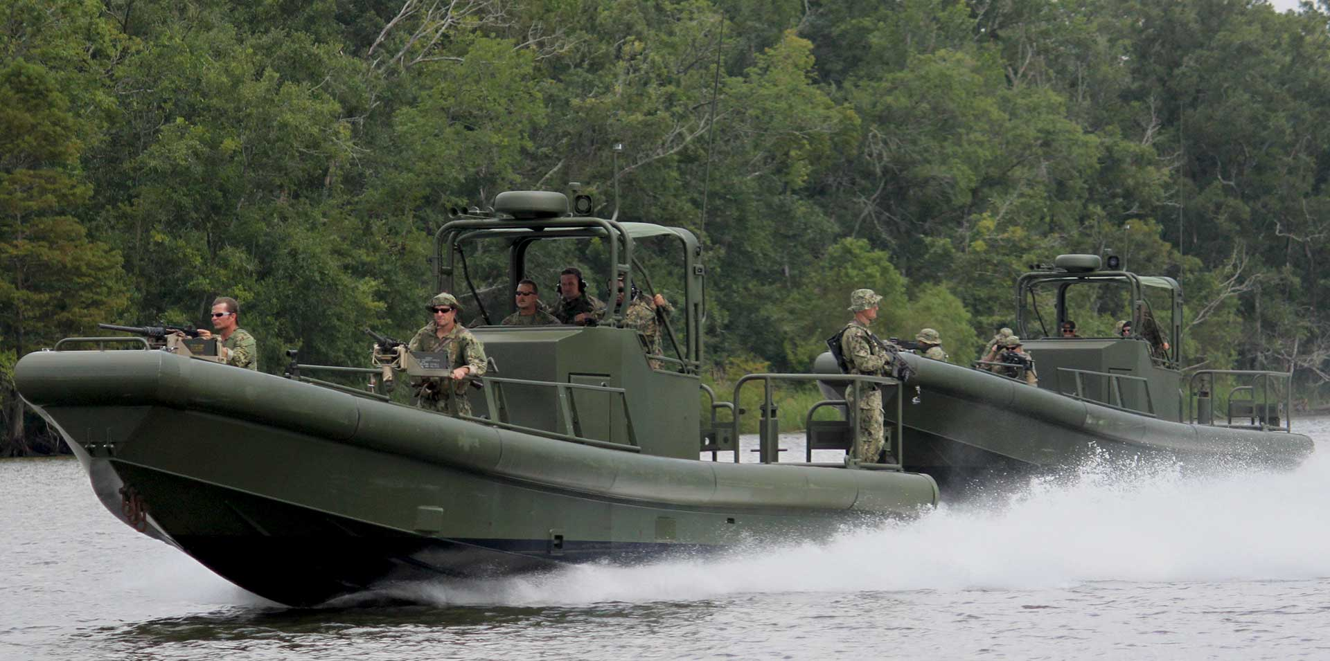 Silver Ships riverine patrol boats with soldiers in the jungle