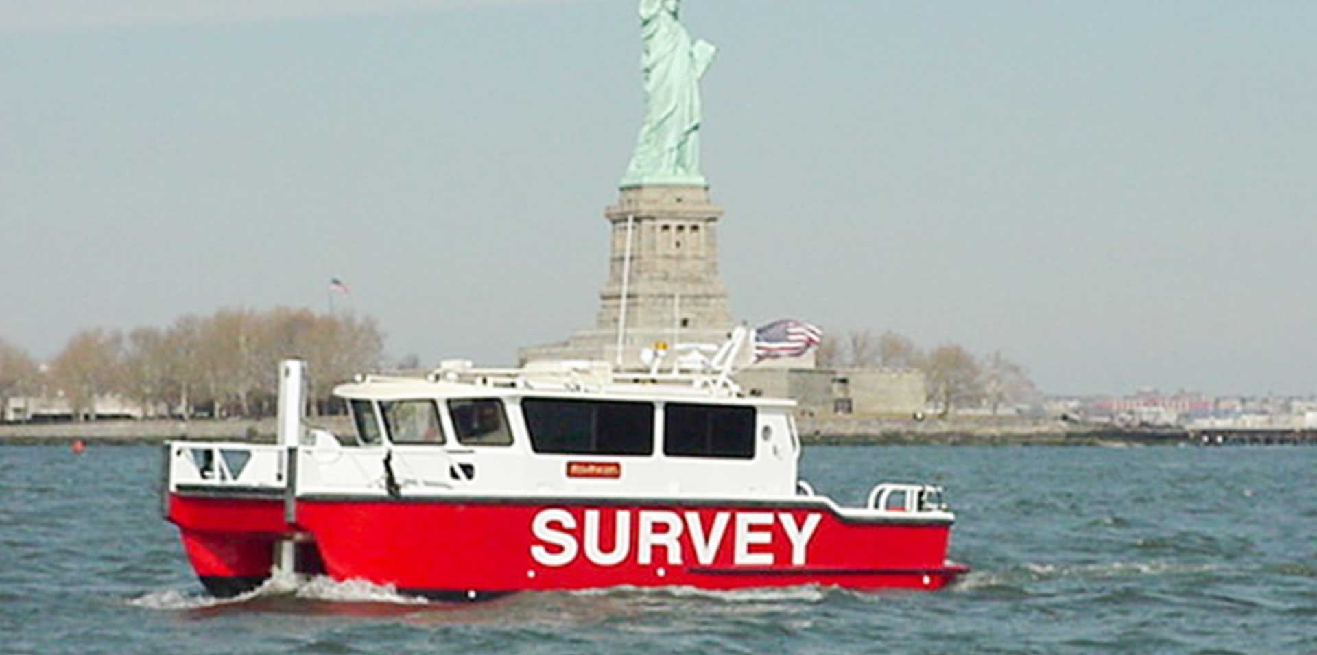 Silver Ships survey boat in front of Statue of Liberty